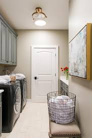 beadboard paneled laundry room door with black front washer and dryer