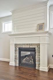 clean white custom milled fireplace surround with shiplap and stone accents bickellbuilt
