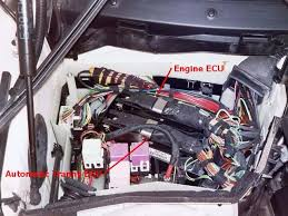 bmw 1997 540ia ecu removal locate the correct ecu and remove the wiring harness by lifting the metal release arm pic 1 the harness has a hook on the right side pic 2 that needs