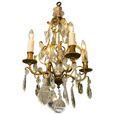 petite french brass and crystal chandelier with four arms circa 1900 for