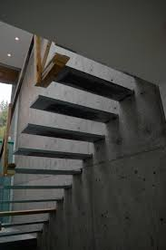 STEEL-CANTILEVERED-STEPS-ATTACHED-TO-CONCRETE-WALL