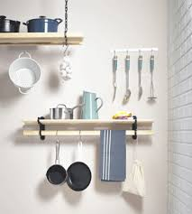 The Kitchen Pot Rack And Utility Shelf Rack Mounted On The Wall In The