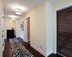 lighting for hallway. traditional dark wood floor and brown hallway idea in minneapolis with beige walls lighting for i