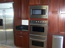 great bake wall with microwave above double oven.