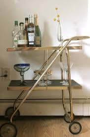Vintage bar cart with chalkboard paint top.