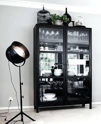 tall black cabinet with glass doors walnut