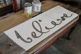 word stenciling on salvaged wood