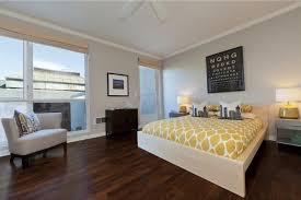 modern hardwood floor designs. Bedroom, Contemporary Cozy Bedroom Style Yellow Polkadot Sheet Bed White Wooden Platform Dark Brown Hardwood Floor Grey Armless Chair Leg Jar Table Light Modern Designs J