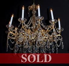 french post war bronze chandelier with crystal bobeches center and solid ball with lapidary cut at bottom gracefully dd with crystal ropes and