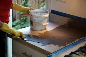 applying the feather finish concrete skim coat to the laminate countertop