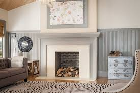 metrie s truft craft trim elements creates a distinctive fireplace treatment