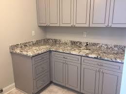 alaska white granite laundry by luxury countertops