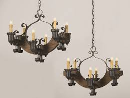 antique and vintage pair old wood chandeliers with black cast iron