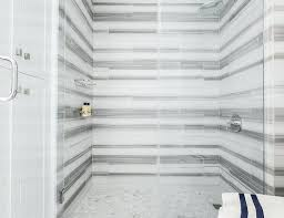 white shower floor tile white and gray striped marble tile surround with marble chevron shower floor