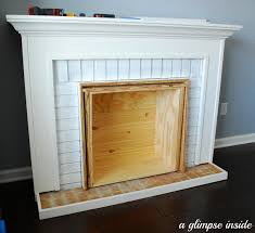 obviously this is a fake fireplace but we wanted it to blend in so travis knotched out the molding where the sides would meet the wall so it would slide