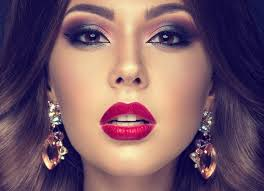 beautiful woman with arabic make up red lips and curls beauty face
