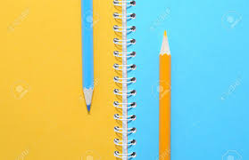 Blue And Yellow Pencils On Notebook With Colored Blank Pages