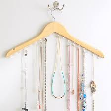 diy clothes hanger jewelry storage via