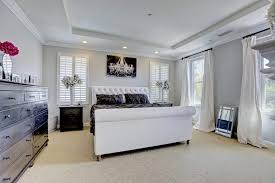 picture chandelier lamp dressers and chest black two nightstands white king size bed with tufted headboard cotton curtain black comforter set wide cream