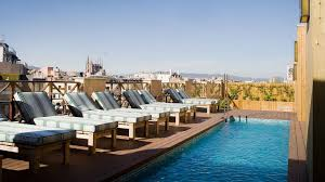 hotel outdoor pool. Luxury Services At The COTTON HOUSE HOTEL, AUTOGRAPH COLLECTION. Bookshop, Terrace And A Roof Swimming-pool In Center Of Barcelona. Hotel Outdoor Pool