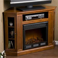 corner tv stand with fireplace. corner electric fireplace tv stand burning with
