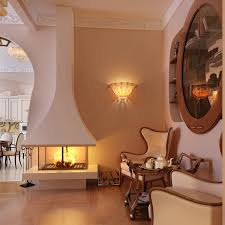 living room wall lights with classic wall sconces over modern fireplace and wingback armchair