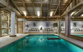 indoor home swimming pools. Modern Indoor Swimming Pool With Wooden Roof And Swing Home Pools A