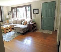 Mesmerizing Alluring Laminate Floor And Beautiful Green Door And Stunning  Sofa Gray Colors