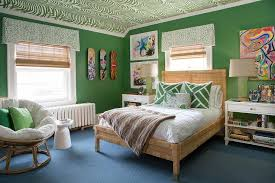 kelly green boys room with rattan bed
