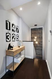 inspired pendant lights method new york contemporary hall remodeling ideas with console table dark wood floor dark wood flooring dark wood stairs