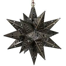 large ornate punched tin star fixture
