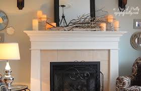 stunning everyday fireplace mantel decor with glass candle holder and black frame wall mirror