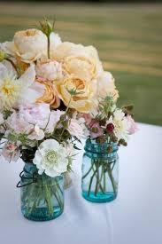 Blue Mason Jars Wedding Decor blue mason jars with flowers for wedding centerpiecesWedWebTalks 38