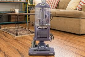 our pick for the best vacuum for hardwood floors standing upright in a living room