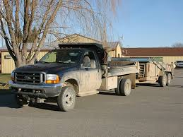 1-Tons & Single Axle Trucks - Roll-Rite Tarp Systems and Power Solutions
