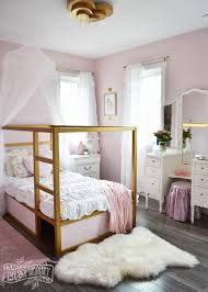 a shabby chic glam girls bedroom design idea in blush pink white and gold with