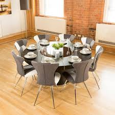 luxury large round black oak dining table lazy susan plus eight chairs 4173 black white