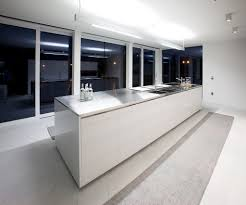 white kitchen windowed partition wall: inspiring minimalist kitchen with island bar and glass windows