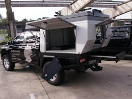 This pop-up camper transforms any truck into a tiny mobile home in ...