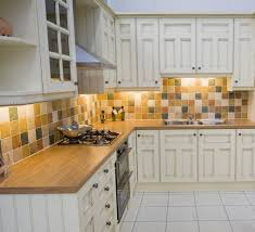 cool primitive backsplash ideas with white cabinets and brown countertop