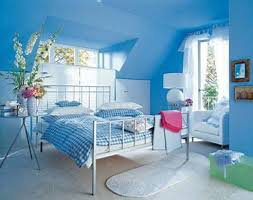 This room is dominated by a soft powder blue color, along with light green  accents