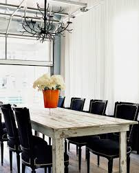 black and white dining table set: eclectic rustic modern dining room design with white washed dining room table black velvet dining chairs with nail head trim white drapes and black iron