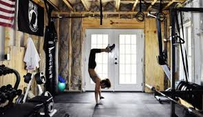 doing handstands in the custom studio gym inspirational garage gyms ideas s15