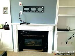 stone fireplace design ideas with tv above gas mounting can you hang a over abov tv over fireplace