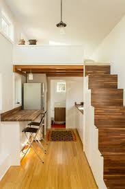 Small Picture Gorgeous Tiny House Boasts 14 Windows and Nifty Storage Stairs