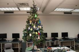 Heavily Decorated Christmas Tree In Family Room Of Upper Middle Classroom Christmas Tree