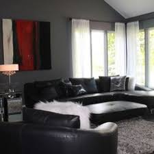 love the black furniture and grey walls. the white accents lighten it up.  Red Living RoomsLiving ...