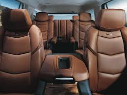 daily news staff the escalade s cavernous interior sports more than enough room for seven passengers between its three rows