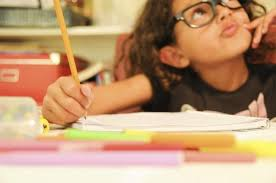 what do i want to be when i grow up activities for kids   ehowa young girl is writing an essay at home