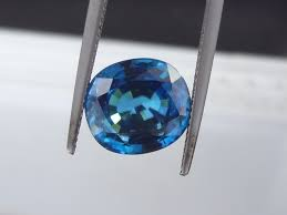 extra large blue zircon from cambodia for with great peacock blue colour this zircon